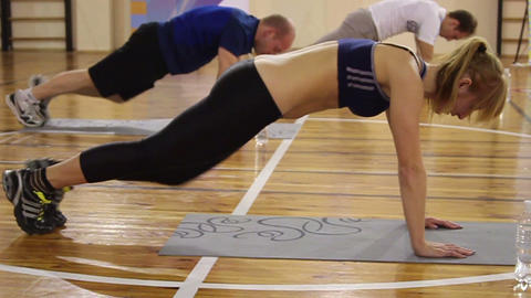 Plank position workout in gym. Knees to chest exercise Live Action