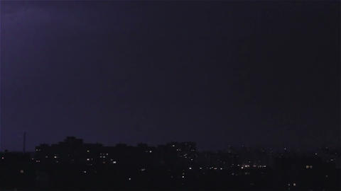 Thunder and lightning above city sky. Lightning forks to buildings, sound ビデオ