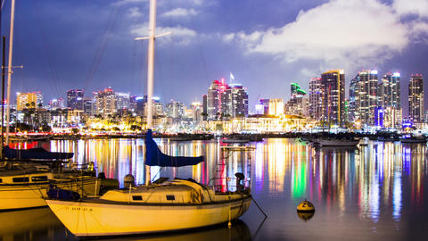 Time Lapse - San Diego Night Time Skyline with boats at waterfront Footage
