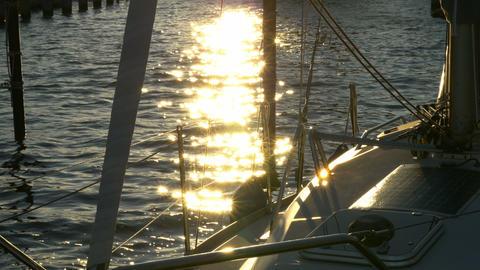 Sailboat harbor sunset - Sailing, sail, ship, boat in marina. Baltic Sea Live Action