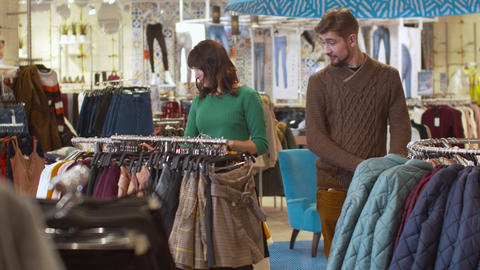 Man and woman flirt in the store Footage
