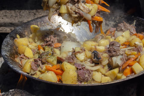 Beef with vegetables cooked in a wok on fire in a mobile kitchen Photo
