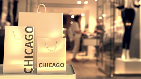 Shopping bags with CHICAGO text against blurred store. American shopping related GIF