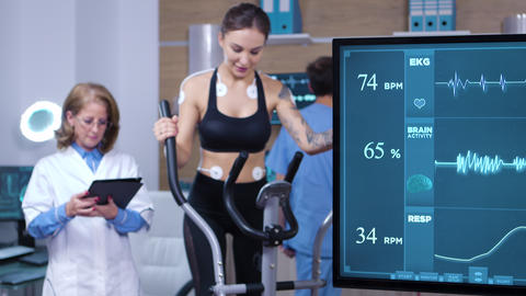 Female athlete using modern equipment to increase her performance Footage