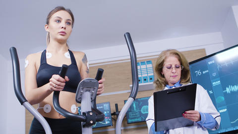 Female runner testing her cardio in a professional testing centre Footage