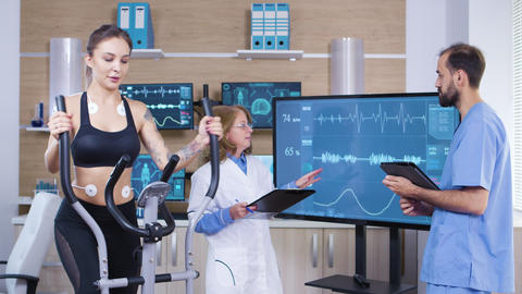 Scientist in sport industry checking the cardio of female athele Footage
