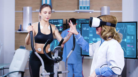 Female scientist with virtual reality goggles for sport measuring Footage