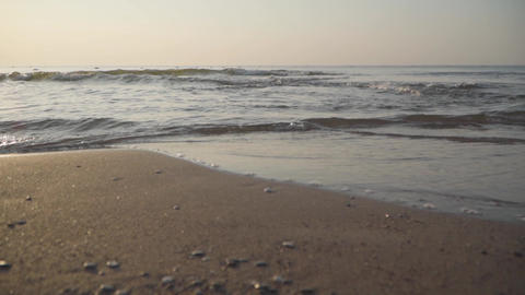 Camera approaching waves of Mediterranean Sea rolling to the sandy beach Footage