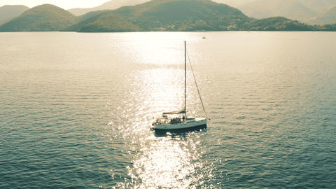 Aerial view of unknown people having fun on a sailing yacht at the Ionian Sea Footage