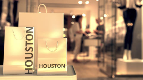Shopping bags with HOUSTON text against blurred store. American retail related GIF