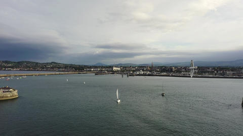Aerial view of a seagull and sailing boats, ships and yachts in Dun Laoghaire Footage