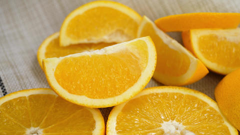 Sliced Orange Fruit on White Tablecloth ビデオ