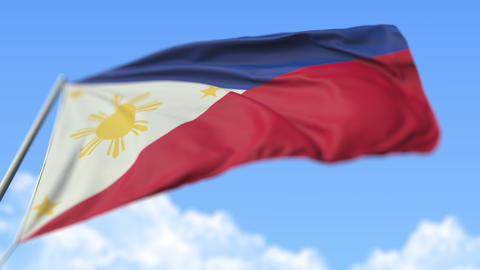 Flying national flag of the Philippines, low angle view. Loopable realistic slow Live Action
