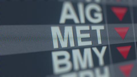 METLIFE MET stock ticker on the screen with decreasing arrow. Editorial crisis GIF