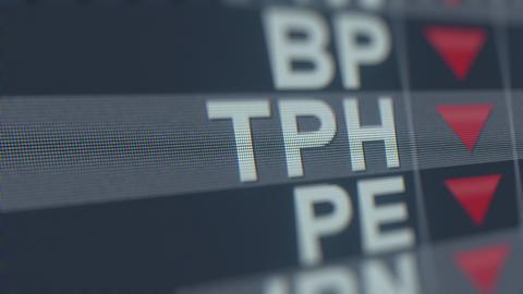 TRI POINTE GROUP TPH stock ticker with decreasing arrow. Editorial crisis GIF