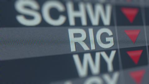 Stock exchange ticker of TRANSOCEAN RIG with decreasing arrow. Editorial crisis GIF