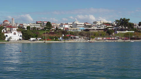 Greek coastal village with low-rise buildings and Orthodox churches GIF