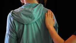 Dancer gives shoulder and back massage Archivo