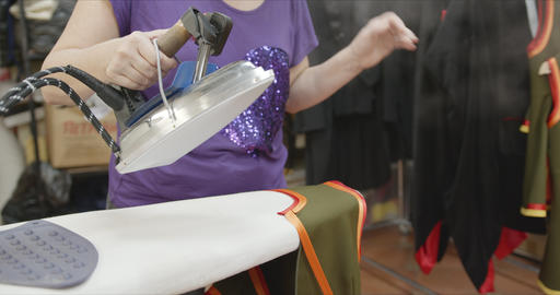 Seamstress ironing details of clothes in sewing workshop Footage