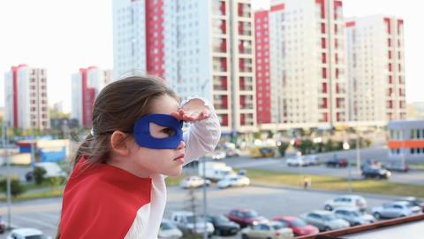 Superhero kid against urban background Footage