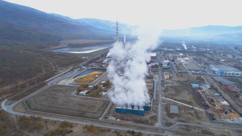 Aerial View of Metallurgical Plant Factory with Smoke Coming Out of Factory Live Action