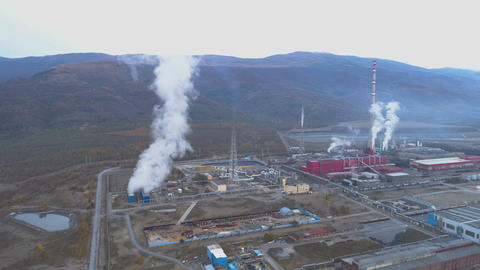 Aerial view of copper smelter and refinery Factory in open field. Smoking pipes GIF
