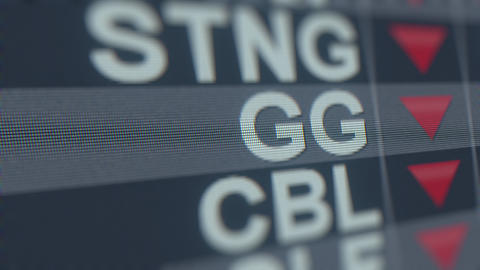 GOLDCORP GG stock ticker with decreasing arrow. Editorial crisis related GIF