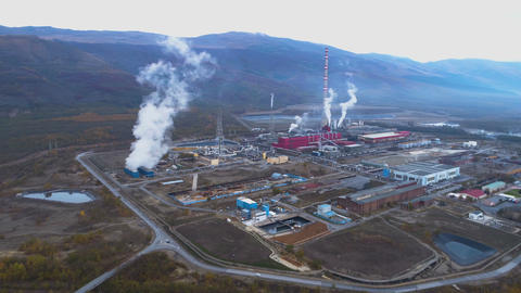 Aerial view of copper smelter and refinery. Air pollution Smoking factory pipes GIF
