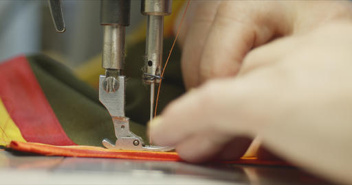 Woman seamstress working on an industrial sewing machine Archivo