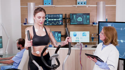 Female athlete testing her heart rate in a sport centre ビデオ