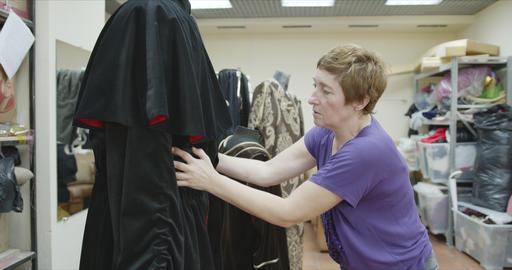 Seamstress works on a garment Archivo