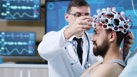 Patient prepared for brain scan in modern facility ビデオ