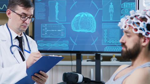 Patient in a modern clinic for brain research ビデオ
