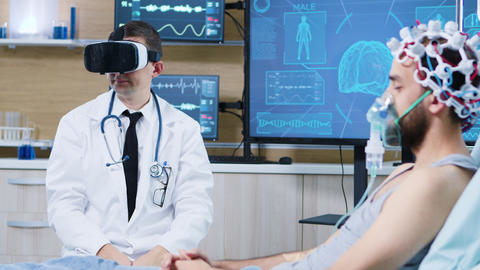 Doctor in a neuroscience centre wearing a virtual reality goggles GIF