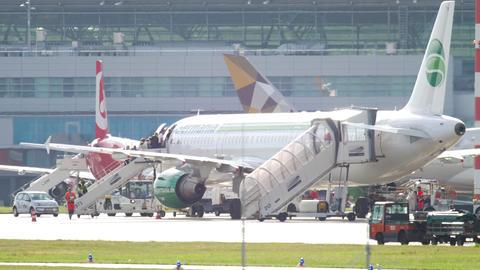 Passengers boarding airplane GIF