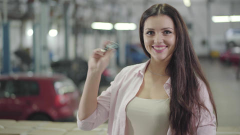 Happy young Caucasian girl kissing car keys, clapping hands and smiling Footage