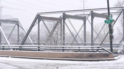 Bridge and Road in Snowstorm Pan Footage