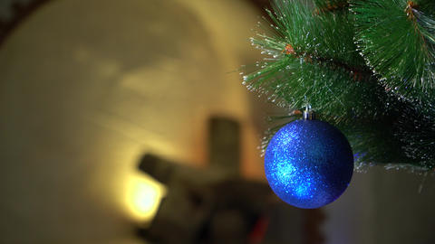 Blue Christmas ball in the flicker of colored lights ビデオ