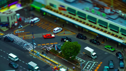 A timelapse of high angle view in front of the station in Tokyo daytime cloudy GIF