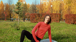 Fitness woman training exercise outdoor in autumn park in city. Sport coach Footage