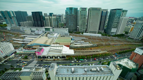 A timelapse of panoramic view in front of the station in Tokyo cloudy wide shot GIF
