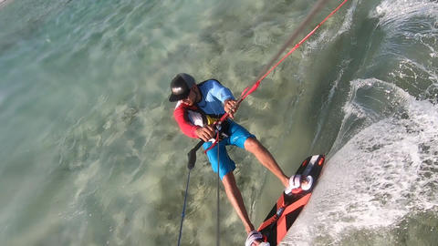 Kitesurfing action, a man is gliding and jumping on high… Stock Video Footage