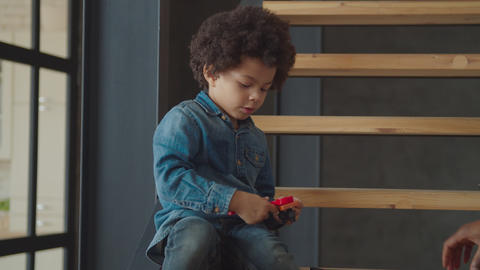 Concentrated mixed race boy using toy wrench Archivo