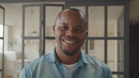 Friendly handsome black man smiling indoors Archivo