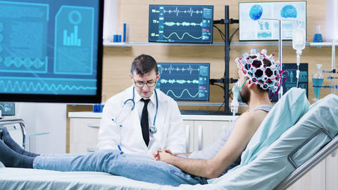 Doctor in a modern neurology centre talking with his patient GIF