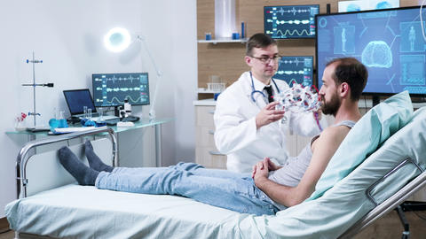 Doctor in neuroscience making adjustments to brain sensors on patient GIF