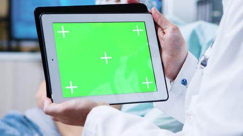 Doctor holding tablet with green screen in a clinic for brain research GIF