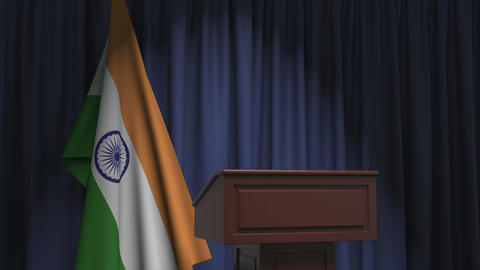 Flag of India and speaker podium tribune. Political event or statement related Live Action