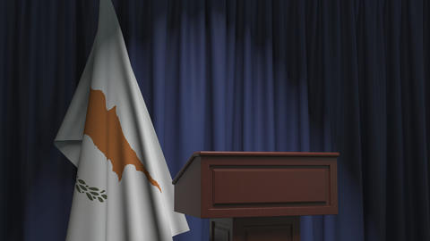 Flag of Cyprus and speaker podium tribune. Political event or statement related Live Action