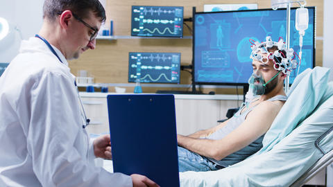 Patient in a neuroscience centre wearing brainwaves scanning headset and air GIF